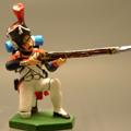 Гренадер в меховой шапке, сидящий, стреляющий
